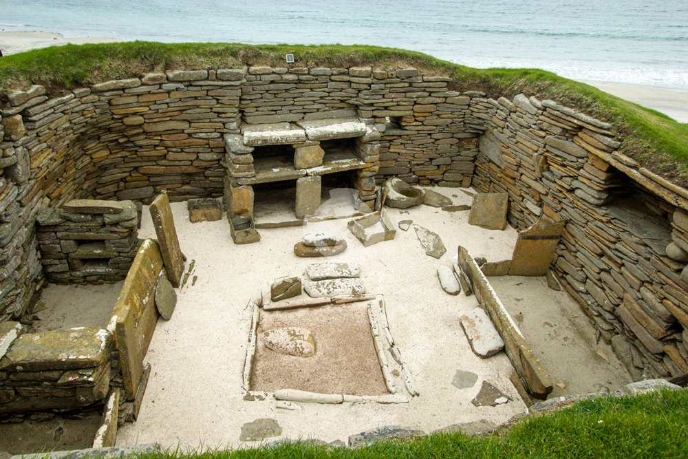 Photo of Skara brae interior showing stone dresser and hearth