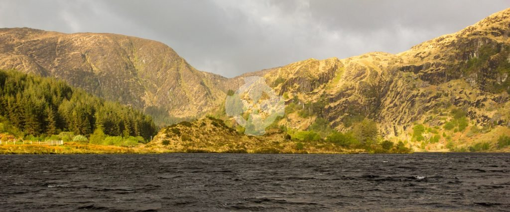 photo showing the wild landscape around gougane barra, in dramatic storm light
