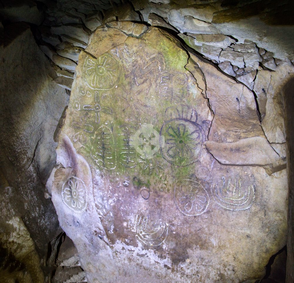 Image of the backwall rock art petroglyphs in Cairn T, Loughcrew.